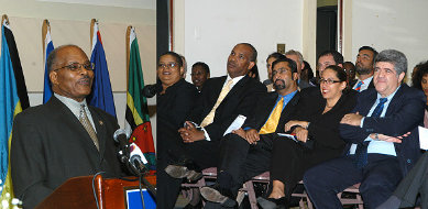 Governor General, His Excellency the Most Honourable Professor Kenneth Hall (left), addresses the audience at a public lecture hosted at the Hilton Kingston Hotel