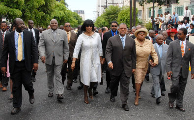 Prime Minister Portia Simpson Miller (centre), leads Members of Parliament for the Government towards Gordon House, before the State Opening of Parliament for the new financial year, 2007/08