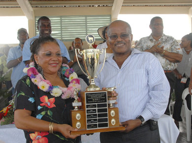 Governor General, His Excellency, the Most Honourable Professor Kenneth Hall presents trophy to Maria Azan, who was crowned Champion Farmer at the 2007 Denbigh Agricultural Show, held at the Denbigh Showgrounds in Clarendon