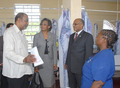 Governor General, His Excellency Professor Sir Kenneth Hall (2nd right), listens to Senior Medical Officer at the Princess Margaret Hospital Cecil Batchelor (left) during a tour of the facility in St. Thomas. Looking on are Lady Rheima Hall (2nd left) and Acting Matron at the hospital, Marjorie Howell.