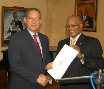 Prime Minister Bruce Golding (left), accepts the proclamation officially declaring February as Reggae Month, from Governor General, His Excellency, the Most Hon. Professor Sir Kenneth Hall during the ceremony to launch the event at King's House