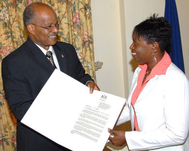Governor General, His Excellency, The Most Honourable Professor Sir Kenneth Hall (left) presents the Proclamation formally declaring April 13-19 as Special Libraries Week, to Chairperson, Special Libraries Section, Claudia Sutherland, following its reading at King's House on Thursday (April 10). The Proclamation was read by Sir Kenneth.