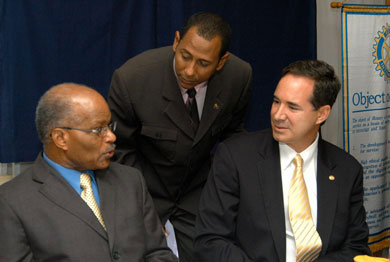 Governor-General, His Excellency the Most Hon. Professor Sir Kenneth Hall (left), engages in discussion with President of the Rotary Club of Kingston, Christopher Issa (right), at the official launch of Rotary Leadership Initiative, at the Pegasus Hotel in Kingston on October 2. Looking on is Co-ordinating Chairman of the National Leadership Initiative, Andre Hylton.