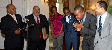 The 2009 Jamaica Rhodes Scholar, Michael Waul (2nd right), is elated at the news of his selection, during the announcement by Governor-General, His Excellency, the Most Hon. Professor Sir Kenneth Hall (left), at King's House on November 14. Others from left are: Secretary of the Jamaica Rhodes Selection Committee, Peter Goldson, and scholarship candidates, Simone Stewart, Derron Wallace and Jeffrey Brown.