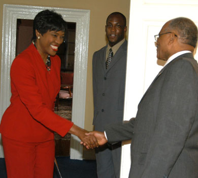 Governor General, His Excellency, the Most Hon. Professor Sir Kenneth Hall, (right) greets Executive Director of the Scientific Research Council (SRC), Dr. Audia Barnett, on her arrival at King's House on Oct 31, for the ceremony officially declaring November as Science and Technology Month. In the background, is Sir Kenneth's Aide-de-Camp, Captain Delando Coriah. The proclamation for Science and Technology Month was read by the Governor General.