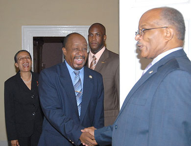 Governor-General, His Excellency the Most Hon. Professor Sir Kenneth Hall (right), welcomes President of the Press Association of Jamaica, Byron Buckley, when he visited King's House on December 1. The President was accompanied by First Vice President of the Association, Fae Ellington (left). At second right is the Governor-General's Aide-de Camp, Captain Delano Coriah.