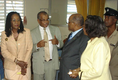Senior Medical Officer at the St. Ann's Bay Hospital, Dr. Horace Betton (second left), in discussion with Governor-General, His Excellency the Most Hon. Professor Sir Kenneth Hall and Lady Hall, when they visited and toured the hospital on December 15. At left is Norma Walters, wife of the Custos of St. Ann, and at right is Deputy Superintendent of Police, Richard Brown.