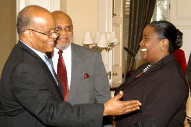 Governor-General, His Excellency the Most Hon. Professor Sir Kenneth Hall (left), welcoming Chief Executive Officer (CEO) of the Dispute Resolution Foundation, Donna Parchment (right), at King's House today (January 6), while Chairman of the Foundation, Novar McDonald (centre), looks on. Occasion was the reading of a proclamation by the Governor-General, declaring 2009 as the 'National Year of Dispute Resolution'.