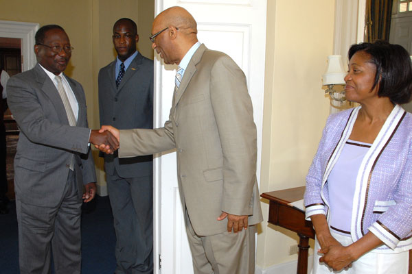 Governor-General, His Excellency the Most Hon. Dr. Patrick Linton Allen (second right), greets President of the Commonwealth of Dominica, His Excellency, Dr. Nicholas Liverpool (left), when he visited King's House on February 27. Also sharing in the moment are: Her Excellency the Most Hon. Mrs. Allen and the Governor-General's Aide-de-Camp, Delando Coriah. Dr. Liverpool's visit was the first courtesy call on the new Governor-General, who assumed office on February 26.