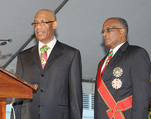 Governor General His Excellency the Most Hon. Dr. Patrick Allen (left) takes theOath of Office as the sixth Governor General of Jamaica, during the swearing-in ceremony on the lawns of King's House today (Feb. 26). Looking on is his predecessor, His Excellency the Most Hon. Professor Sir Kenneth Hall.