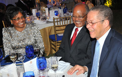 Prime Minister, Bruce Golding (right), is in light conversation with Governor-General, His Excellency the Most Hon. Professor Sir Kenneth Hall and Lady Hall, at a farewell dinner, which the Prime Minister hosted for Sir Kenneth last night (Feb. 20) at Jamaica House.