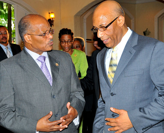 Governor General of Jamaica, His Excellency, the Most Honourable, Dr. Patrick Allen, (right) converses with former Governor General, the Most Honourable Professor Sir Kenneth Hall during the Governor General's Achievement Awards Scheme luncheon held at the Terra Nova All Suite Hotel in Kingston on March 25.