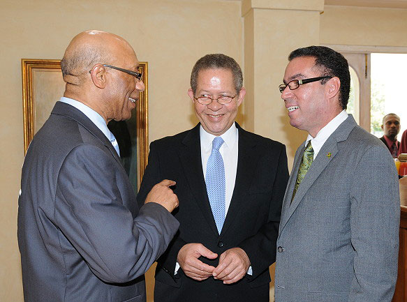 Governor-General, His Excellency the Most Hon. Dr. Patrick Allen (left), shares a light moment with Prime Minister Bruce Golding (centre), and Minister of State in the Office of the Prime Minister, and Member of Parliament for West Portland, Daryl Vaz, following a brief ceremony at King's House, on April 1, during which Mr. Vaz was sworn into office.