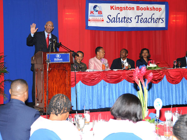 Governor General, his Excellency, the Most Hon. Dr. Patrick Allen (at podium) delivering his keynote presentation at the Kingston Bookshop Teachers' Luncheon at the Hilton Kingston Hotel on Tuesday(March 5). At the head table from left are: Chairperson for the function, Fae Ellington; Principal of Lyssons Primary School, Ena Barclay; President of the Jamaica Independent Schools' Association, Basil Tabanor; and Director of Administration at the Kingston Bookshop, Sonia Fuller.