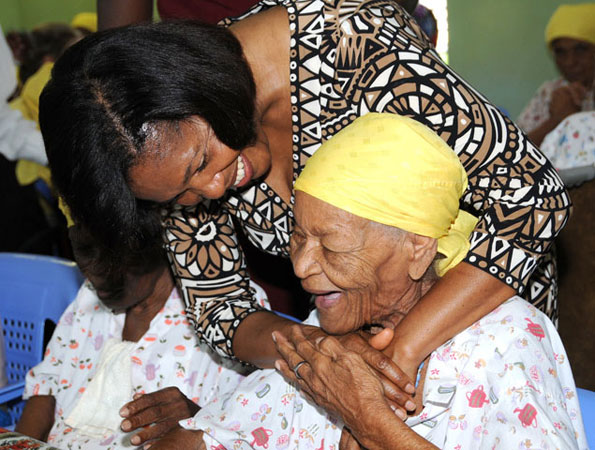 Wife of the Governor-General, the Most Hon. Mrs. Allen, embraces a resident at the Missionaries of Charity Home for the Aged, Sophia, during a tour of the facility in downtown Kingston on Tuesday (June 2).