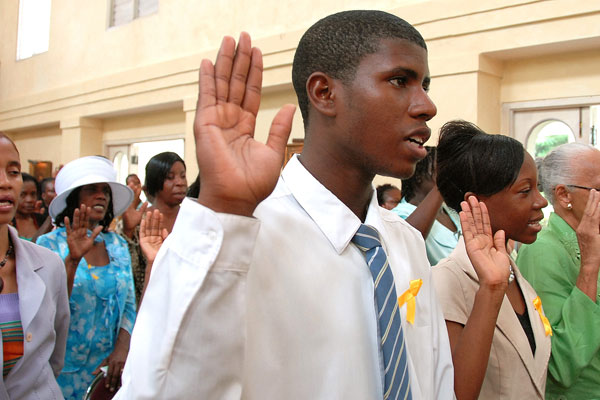 Volunteers with the Jamaican Foundation for Lifelong Learning (JFLL) take their oath during the swearing in ceremony held today (June 23) at King's House. Governor General, His Excellency the Most Hon. Sir Patrick Allen, presided over the ceremony.