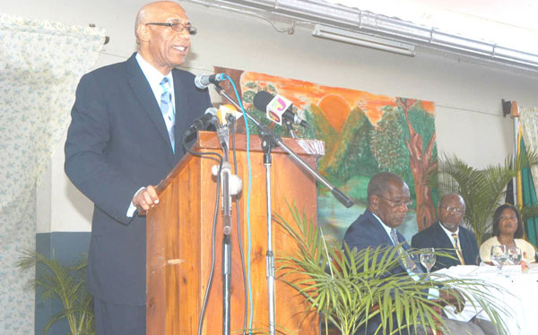 Governor-General, His Excellency the Most Hon. Sir Patrick Allen, addresses a function on July 9 at Beadle Hall in Santa Cruz, St. Elizabeth, which was hosted by the St. Elizabeth Lay Magistrates Association. Others (seated from left) are: Custos of the parish, Hon. Alfred Farquharson; President of the St. Elizabeth Lay Magistrates Association, Wilfred Nembhard; and Her Excellency the Most Hon. Lady Allen.
