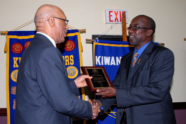 Governor-General, His Excellency the Most Hon. Sir Patrick Allen receives a plaque signifying his acceptance into the Kiwanis Club of Kingston as an honorary member, from the President, Ralston Nunes, during Tuesday's (July 14) luncheon meeting at the Hilton Kingston Hotel.