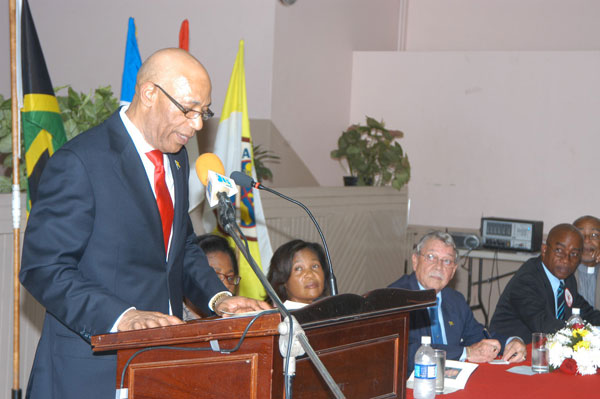 Governor-General, His Excellency the Most Hon. Sir Patrick Allen addressing a civic ceremony, held at St. Gabriel's Anglican Church in May Pen on July 16. Looking on (from second left) are: Her Excellency the Most Hon. Lady Allen; Custos of Clarendon, Hon. James deRoux; and His Worship the Mayor of May Pen, Councillor Milton Brown.