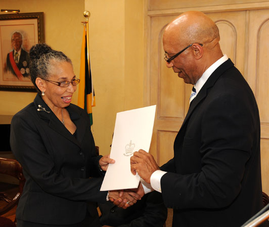 Hon. Justice Hilary Ann Phillips (left) receives the Instrument of Appointment from Governor-General, His Excellency the Most Hon. Sir Patrick Allen at a ceremony at King's House on Monday (July 20) at which she was sworn in as a Judge of the Court of Appeal.
