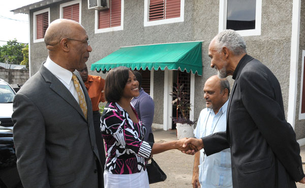 Governor-General, His Excellency the Most Hon. Sir Patrick Allen (left) and Executive Director and Founder of the Mustard Seed Communities, Father Gregory Ramkissoon (second right), look on as Lady Allen (second left), is greeted by Chairman, Board of Directors, Mustard Seed Communities, His Grace, the Most Reverend Donald Reese, during a tour of 'My Father's House', located at 1Mahoe Drive, in Kingston, today (July 27). 'My Father's House' is the headquarters of the Mustard Seed Communities. While on tour, Their Excellencies visited the dormitories, the ceramic studio, meditation garden, the Little Angels Learning Centre and the studios of ROOTS 96.1 FM, where they participated in a live radio interview. The facility, which was opened in 1989, cares for abandoned children with disabilities.
