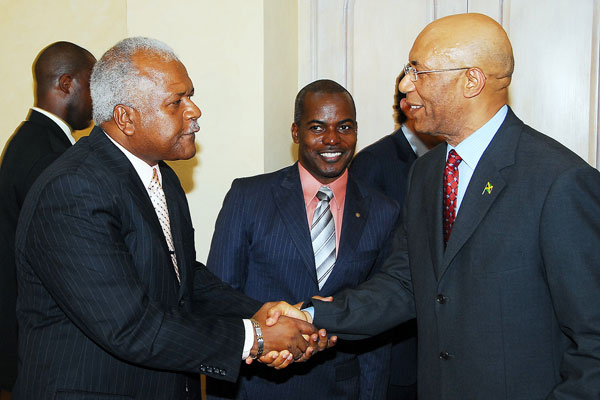 Governor-General, His Excellency the Most Hon. Sir Patrick Allen (right) shakes hands with National Director of the National Transformation Programme (NTP), Rev. Al Miller, during the launch of the NTP, branded Fresh Start Jamaica, at King's House Wednesday (July 29). Looking on is Director of Development and Planning for the NTP, Fabian Brown.
