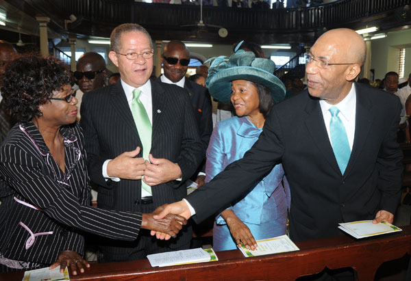Governor-General, His Excellency Sir Patrick Allen (right) greets the wife of the Prime Minister, Mrs. Lorna Golding (left), while Prime Minister Bruce Golding and Lady Allen look during Sunday's (August 2) National Emancipation Thanksgiving Service at the East Queen Street Baptist Church, downtown Kingston, which was held under the theme 'I Believe in Jamaica'.