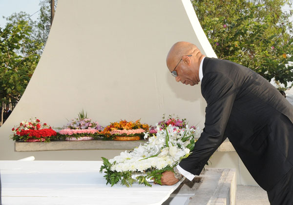 Governor General, His Excellency the Most. Hon. Sir. Patrick Allen, lays a wreath on the grave of the late Lady Gladys Bustamante, widow of National Hero, The Rt. Excellent Sir Alexander Bustamante, during her funeral at National Heroes Park, Kingston, on Saturday (August 8).