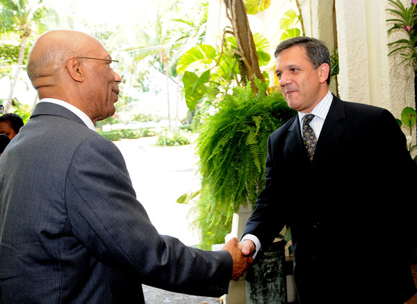 Governor-General, His Excellency the Most Hon. Sir Patrick Allen (left) being greeted by President and Chief Executive Officer (CEO) of the Jamaica Public Service (JPS) Company, Damian Obiglio, at the luncheon marking the presentation of grants for tertiary education, at the Terra Nova All Suites Hotel, Kingston, on Tuesday (August 11). The JPS presented $8 million to assist students in need of financial assistance to four institutions - University of Technology (UTech), University of the West Indies (UWI), Northern Caribbean University (NCU) and the St. Patrick's Foundation.
