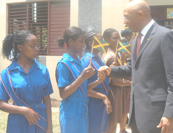 Governor-General, His Excellency the Most Hon. Sir Patrick Allen, meeting students of the Porus High, and Primary Schools, in Manchester, when he stopped at the Porus New Testament Church of God, on August 19. The Governor-General and Lady Allen were on their first official visit to the parish.