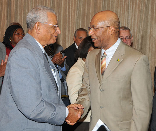 Governor-General, His Excellency the Most Hon. Sir Patrick Allen (right), is greeted by Custos of Kingston, Rev. Canon, the Hon. Weeville Gordon, when he arrived at the Jamaica Pegasus Hotel, in Kingston, today (September 9), for a meeting with Canon Gordon, Justices of the Peace (JPs) from Kingston, and members of the Kingston Chapter of the Lay Magistrates' Association of Jamaica.