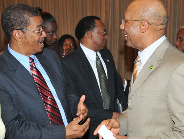 Governor-General, His Excellency the Most Hon. Sir Patrick Allen (right), having a light discussion with President of the Kingston Chapter of the Lay Magistrates' Association of Jamaica, Hugh Cross (left), when he arrived at the Jamaica Pegasus Hotel, in Kingston, today (September 9), for a meeting with Custos of Kingston, Rev. Canon, the Hon. Weeville Gordon, Justices of the Peace (JPs) from Kingston, and members of the Kingston Chapter of the Lay Magistrates' Association of Jamaica.