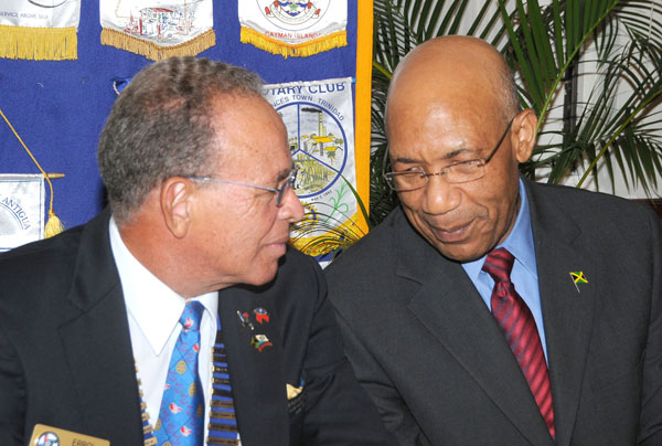 Governor-General, His Excellency the Most Hon. Sir Patrick Allen (right), converses with District Governor of the Rotary Club of Liguanea Plains, Mr. Errol Alberga, during a Club meeting, held at Eden Gardens, in Kingston, on September 10. The Governor-General was inducted as an Honorary Rotarian.