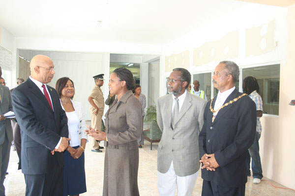 Chief Librarian at the Hanover Parish Library, Miss Merveta Stewart (3rd left), in discussion with Their Excellencies, Governor-General, His Excellency The Most Honourable Sir Patrick Allen (left) and Lady Allen (2nd left), after the Governor-General officially opened an exhibition to commemorate the life and work of the late cultural icon, Hon. Louise Bennett-Coverley. Looking on are: Custos of Hanover, the Hon. Dr. David Stair (2nd right) and His Worship the Mayor of Lucea, Councillor Lloyd Hill.