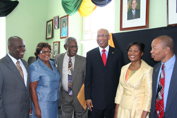 The Governor-General, His Excellency the most Honourable Sir Patrick Allen (third right) and Her Excellency Lady Allen (second right) pose for the cameras following a special sitting of the Trelawny Parish Council which the Governor General addressed. Mayor of Falmouth, Councillor Collin Gager (left), Member of Parliament for South Trelawny, Mrs. Marisa Dalrymple-Philibert (second left),Custos of Trelawny, the Hon Royland Barrett (third left) and Member of Parliament for North Trelawny Dr. Patrick Harris (right) joined him in the occasion.
