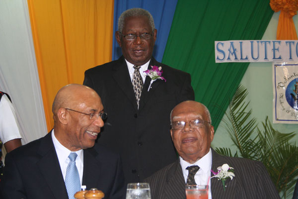 Custos of Trelawny, Hon. Royland Barrett (standing centre) has a moment with Governor General, His Excellency the Most Hon. Sir Patrick Allen (left), and former Governor General, His Excellency the Most Hon. Sir Howard Cooke, at a ceremony held to honour the Custos yesterday (Nov.11) at the Starfish Resort in Trelawny.