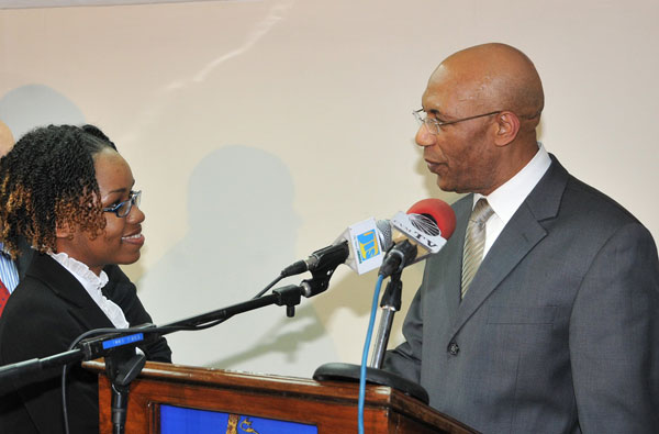 The Governor-General, His Excellency the Most Hon. Sir Patrick Allen, congratulates Alecia John who was named as the 2010 Rhodes Scholar during a ceremony held Friday (November 20) at King's House, Kingston.