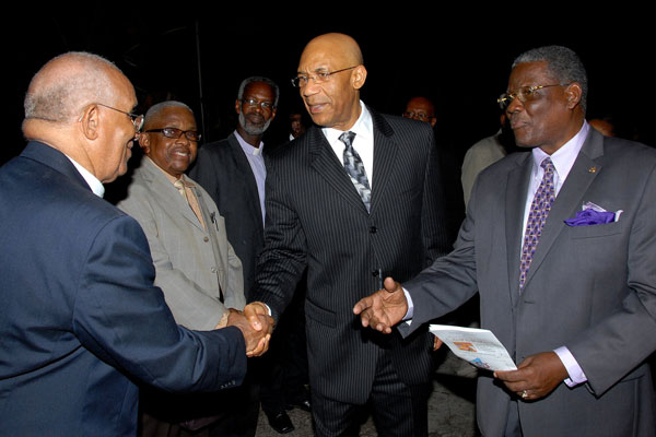 Governor-General, His Excellency the Most Hon. Sir Patrick Allen (second right), is introduced to Rev. Glenn Prince (left), member of the St. Ann's Bay Ministers Fraternal, by Custos of St. Ann, Hon Radcliffe Walters(right), when he arrived for the annual National Prayer Vigil, held at the St. Ann's Bay Baptist Church on December 13.