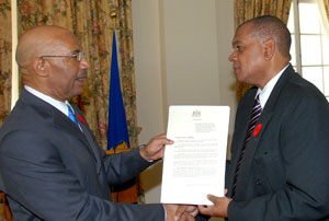 Governor General, His Excellency the Most Hon. Sir Patrick Allen (left), presents Executive Director, National Council on Drug Abuse (NCDA), Michael Tucker, with a copy of the proclamation declaring November Drug Awareness Month, following a ceremony at King's House on Monday (October 31).