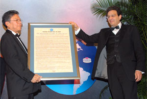 Chairman of the Lasco Affiliated Group of Companies, Hon Lascelles Chin, OJ (left), being presented with the citation by PSOJ President, Joseph Matalon, as he is inducted into the PSOJ's Hall of Fame at the Wyndham Kingston Hotel on Thursday (October 27). Mr. Chin is the nineteenth private sector leader to be inducted into the PSOJ's Private Sector Hall of Fame.