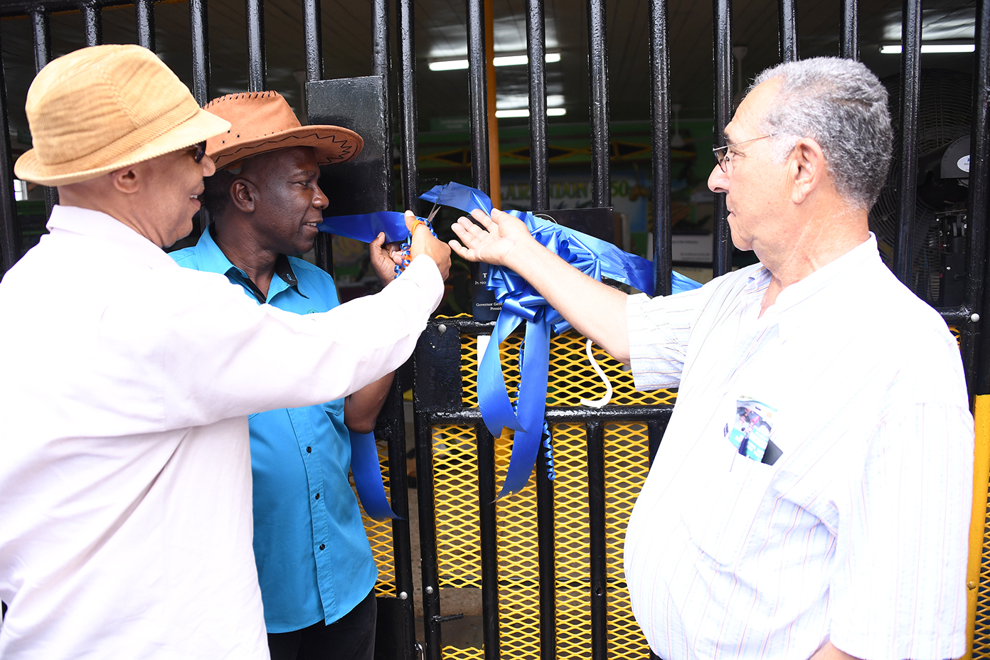 His Excellency Sir Patrick Allen (left) officially opens The Honourable William Shagoury Building. Looking on are the Hon William Shagoury, Custos of Clarendon, (right) and President of Jamaica Agricultural Society, Mr. Norman Grant.