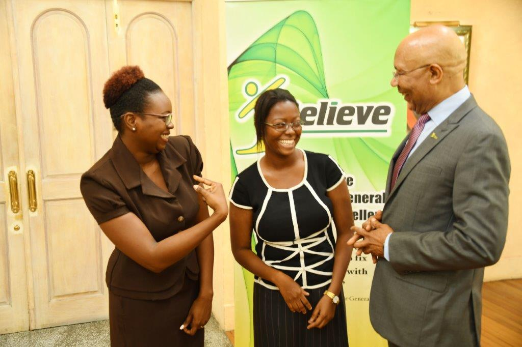 Governor-General Sir Patrick Allen shares a light moment with Ms. Celine Lobban, a scholarship winner in the 2017 I Believe Initiative Summer Of Service Competition, and her sign language interpreter, Mrs. Stephanie Spencer, during the awards ceremony yesterday (August 22, 2017).