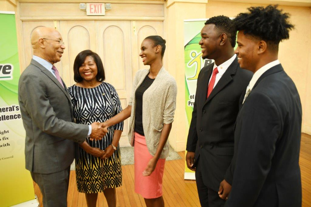 Their Excellencies Sir Patrick Allen and Lady Allen congratulate the top three winners in the 2017 I Believe Initiative Summer Of Service Competition. L-R: Ms. Leneka Rhoden (1 st ), Mr. Vashawn Saxton (2 nd ) and Mr. Timothy Simmonds (3rd ).