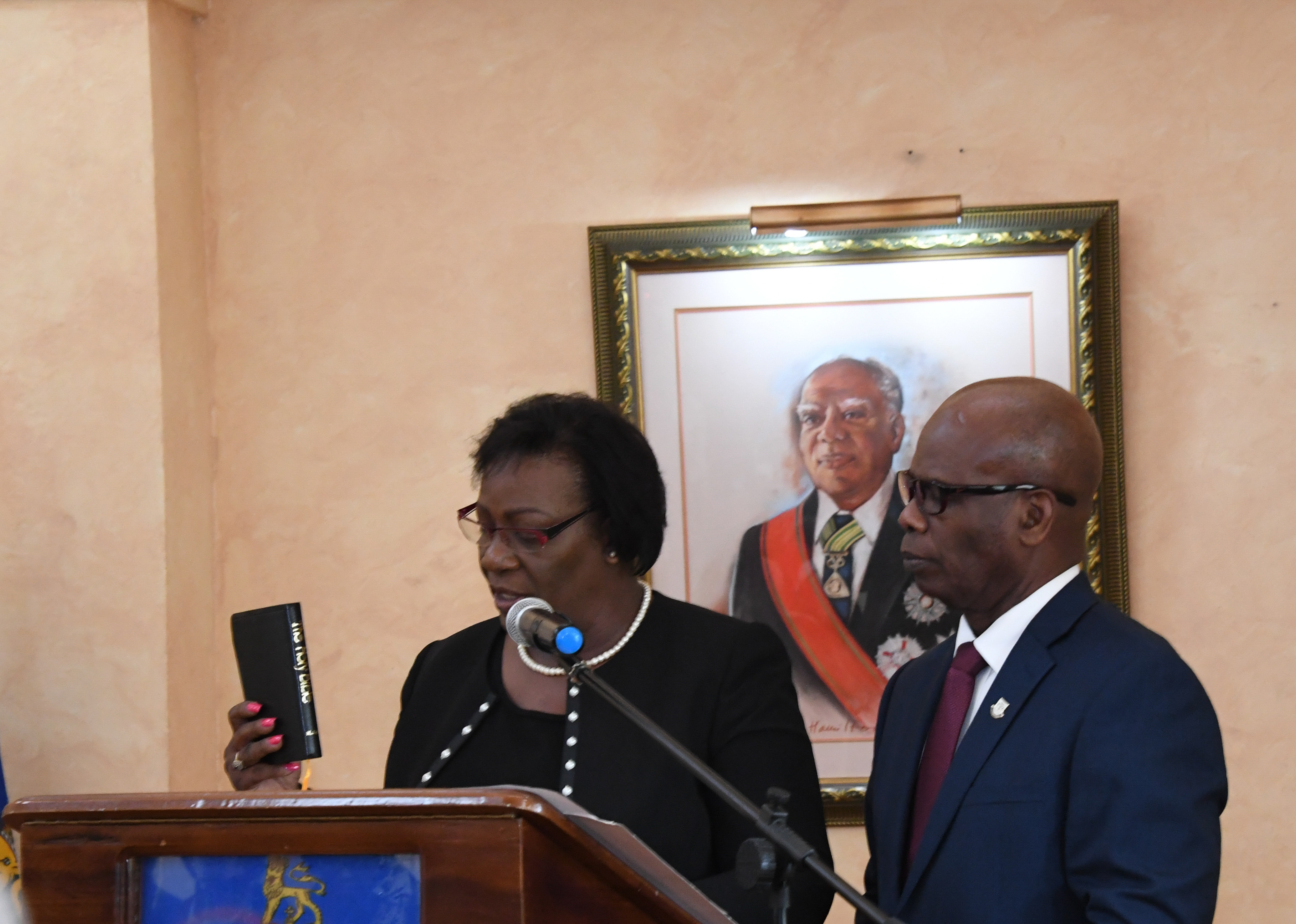 Deputy Governor-General the Honourable Steadman Fuller observes as Her Honour Ms. Judith A. Pusey takes her Oath of Allegiance and Judicial Oath during the swearing-in ceremony at King's House on January 5.