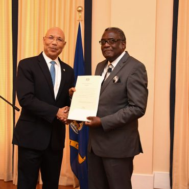 His Excellency the Most Honourable Sir Patrick Allen presents Bishop Conrad Pitkin with his Instrument of Appointment as Custos Rotulorum for the parish of St. James at King's House on January 29, 2018.