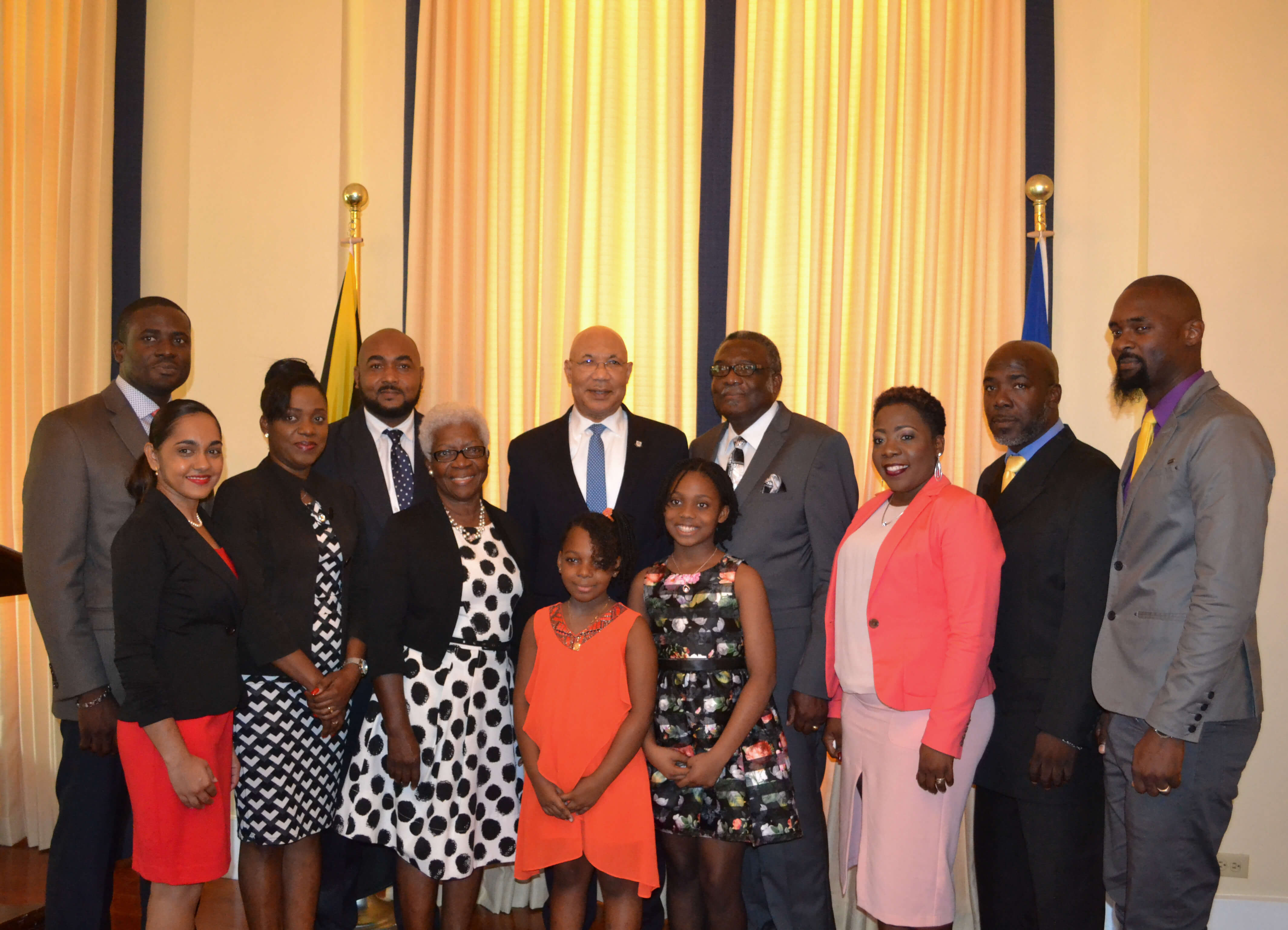 His Excellency the Most Honourable Sir Patrick Allen shares lens with Bishop Conrad Pitkin and his family following his swearing-in ceremony at King's House on January 29, 2018.