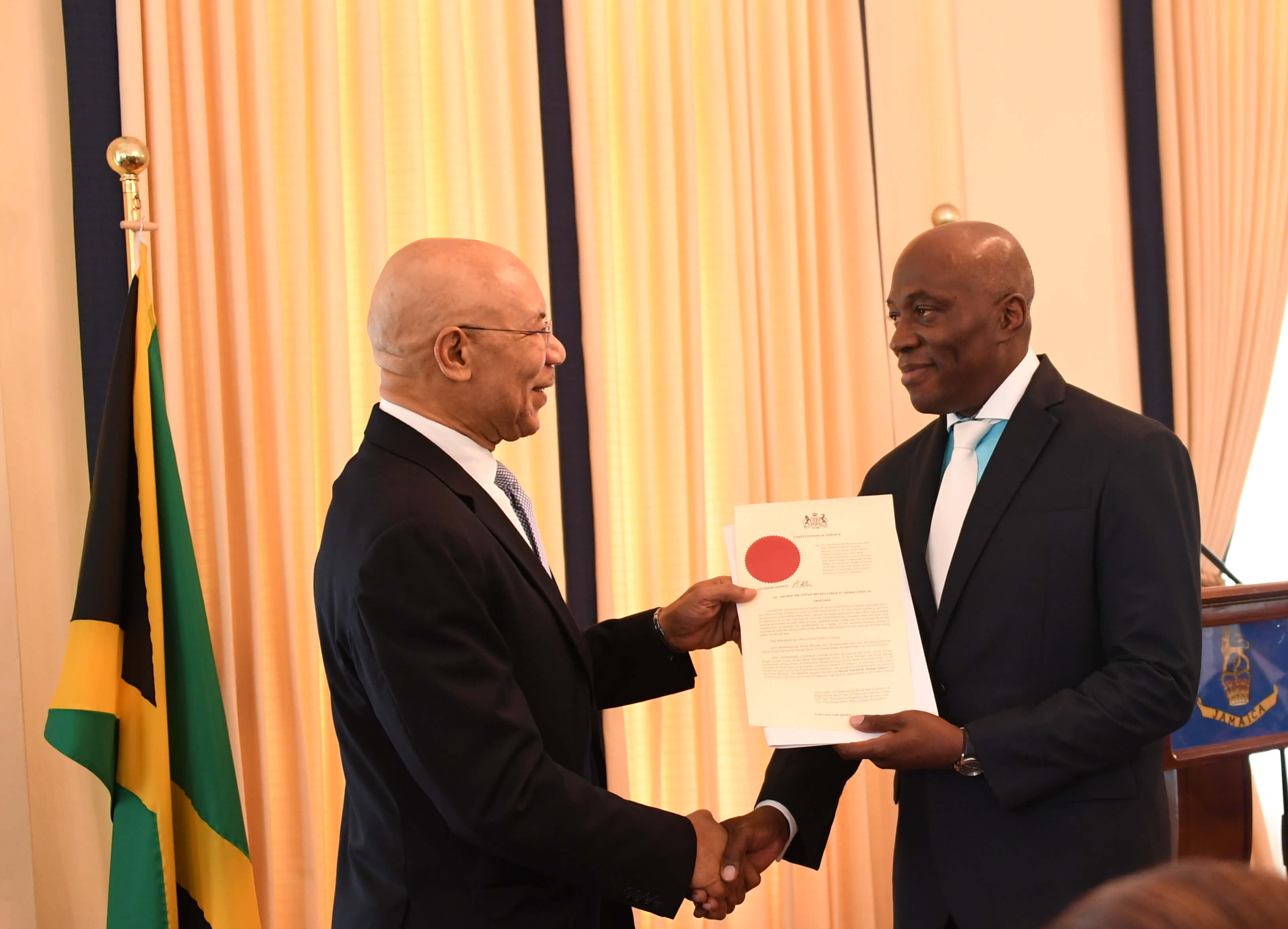 His Excellency The Governor-General presents the Honourable Mr.  Justice Bryan Sykes with his Instrument of Appointment as Chief Justice of Jamaica at a swearing-in ceremony held at King's House on February 1, 2018.
