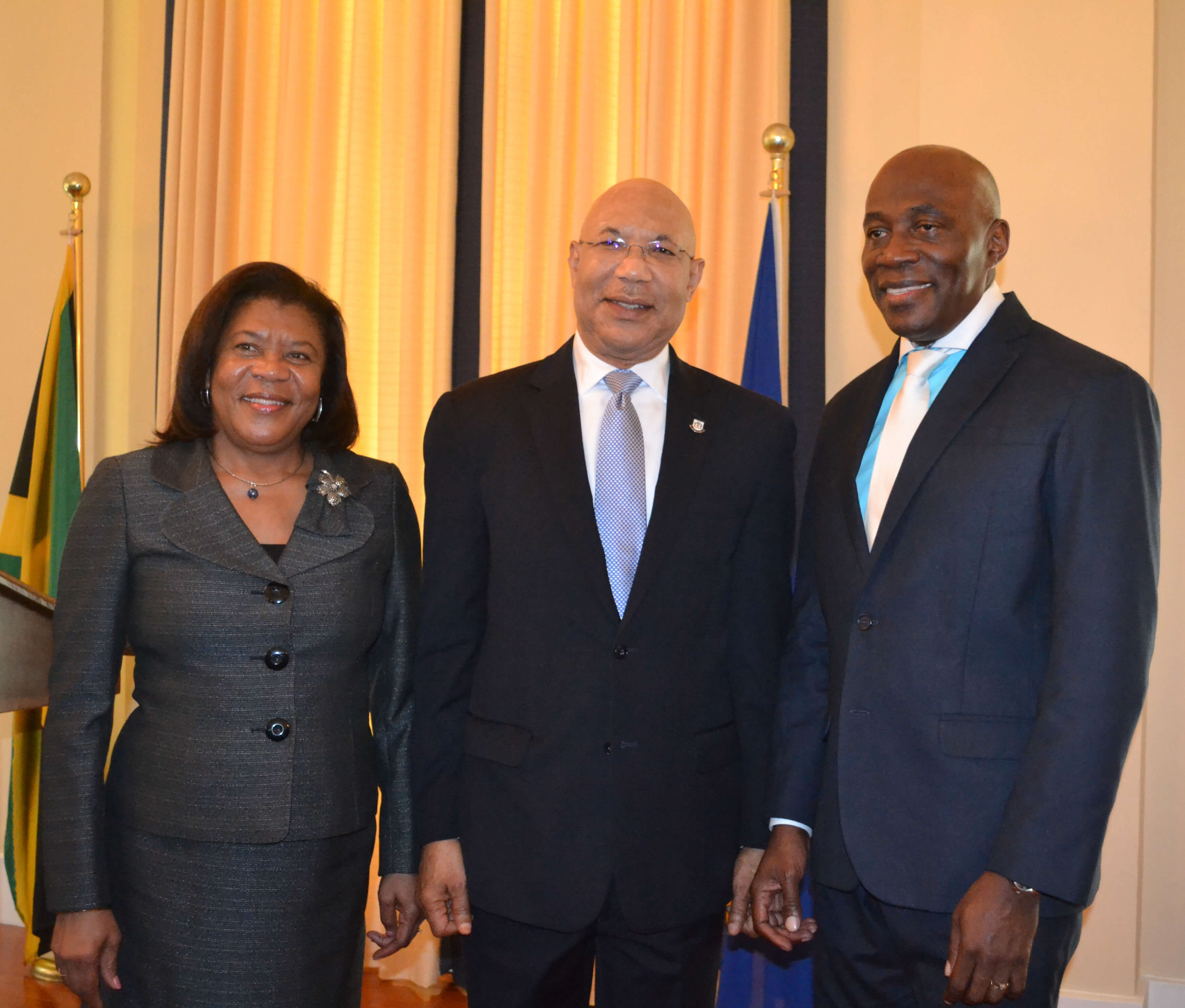 His Excellency The Governor-General (centre) shares lens with Her Honour Mrs. Justice Zaila McCalla (left), outgoing Chief Justice and the Honourable Mr. Justice Bryan Sykes (right) after his swearing-in ceremony to act as Chief Justice.